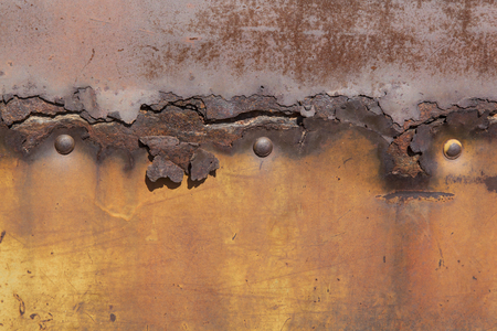 rivets: rusty metal plate background with three rivets Stock Photo