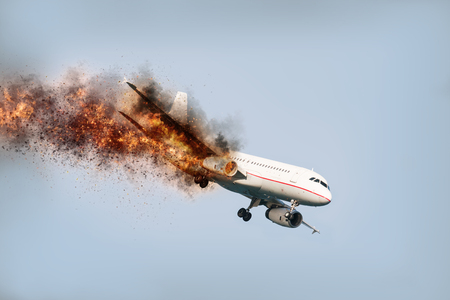 flying aircraft with exploding aero engine just before air crash Stock Photo
