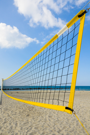 yellow volleyball net at the beach of the german baltic sea, concept for summer vacation and sport; Germany, Europe
