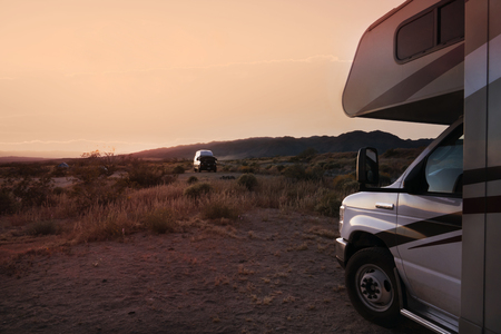 camping in wilderness with recreational vehicle at sunset, California, USA