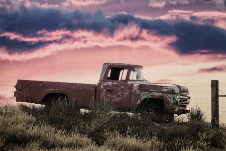vintage pickup truck on a meadow at sunset, concept for Route 66 and american history