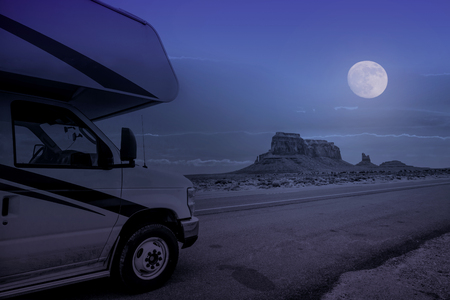 parking recreational vehicle in monument valley at full moon night, Arizona, USA