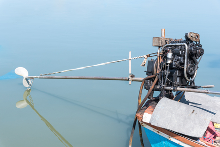 Fishing Boat Engine and Three Bladed Boat Propeller Stock Photo