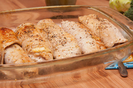 casserole dish: Dinner served. Meat rolls are in the casserole dish