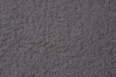 unequal: Background made of a material with a light grey colour in different shades