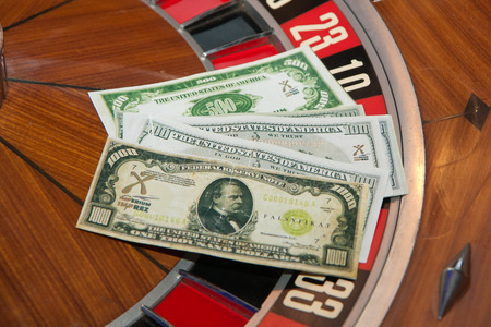 gambling counter: The pile of dollars notes on the roulette. Stock Photo