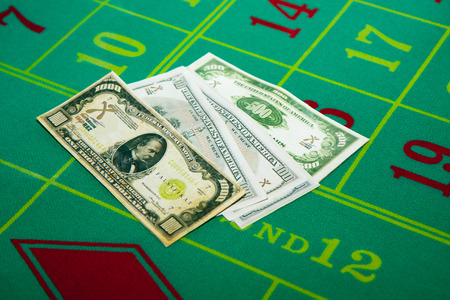 gamble: The pile is  dollars notes on the table to gamble with