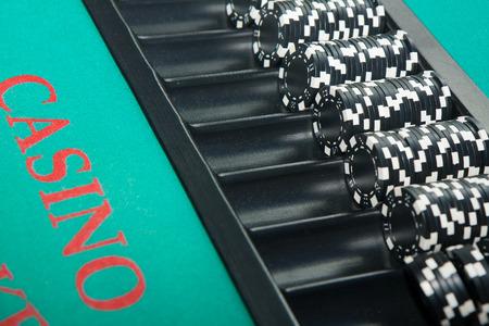 gambling counter: Black and white chips awaiting casino gamblers
