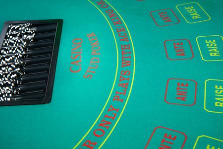 gamblers: Black and white chips awaiting casino gamblers