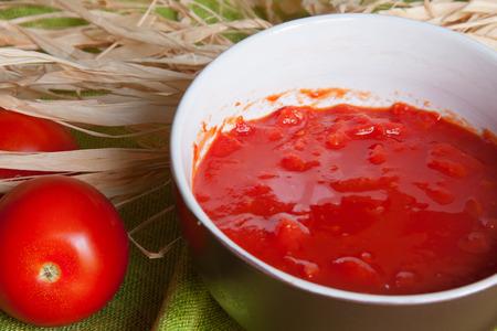 tomato puree: Tomato puree in a  white bowl