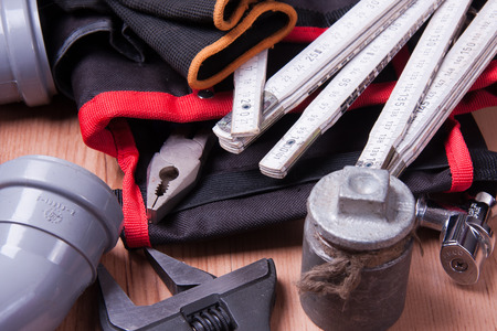 pinchers: Professional plumbing tools and seals placed in the workplace.