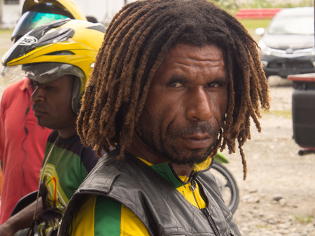 cornrows: Dekai, Indonesia - January 12, 2015: A black man a smiling Editorial