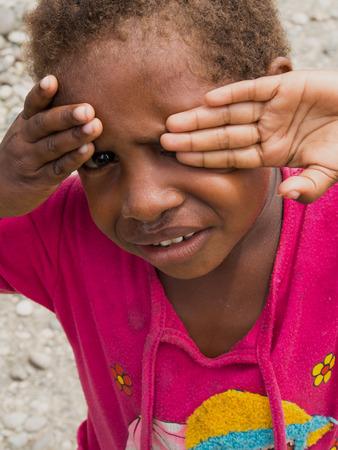 ashamed: Dekai, Indonesia - January 12, 2015: A Local girl  being ashamed.