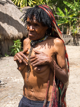 dani: Wamena, Indonesia - January 23, 2015: Women of the tribe Dani have fingers cut as a sign of repentance and mourning for the dead family members.