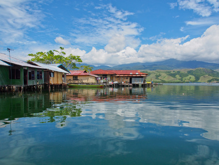 indigence: Jayapura Indonesia January 24 2015: houses built on stilts stand in the waters of Lake Sentai
