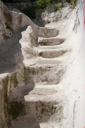 cramped: Traditional Greek narrow and winding stairs painted white Stock Photo