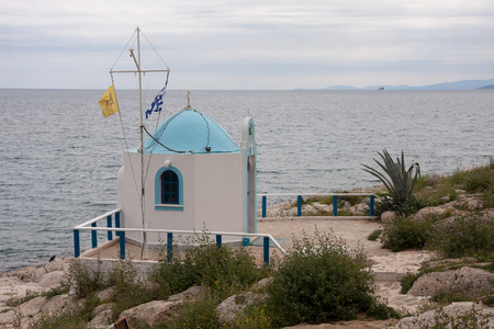 Piraeus, Greece-April 04, 2015: Small newly renovated Greek-Catholic chapel located next to the entrance to the fishing port.