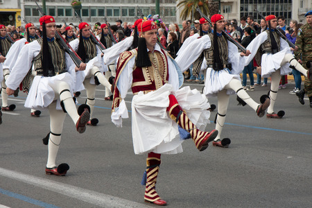 solemn: Athens, Greece, - April 05, 2015: A solemn military parade of soldiers  wearing traditional  uniforms going down the streets of Athens