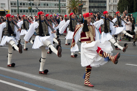 military watch: Athens, Greece, - April 05, 2015: A solemn military parade of soldiers  wearing traditional  uniforms going down the streets of Athens