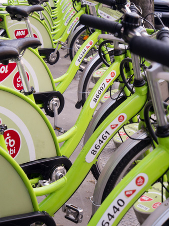 annuities: Budapest Hungary April 152015: Green city bikes aligned in a row on the sidewalk Editorial