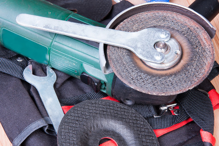 eyeshield: Replacement of the grinding wheel of electric grinder with a help of keys Stock Photo
