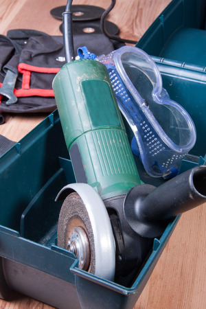 Electric grinder. along with safety glasses placed in a box