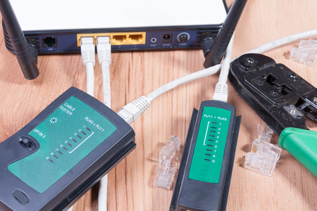 cable cutter: Modemrouter with ethernet cables connected in the sockets