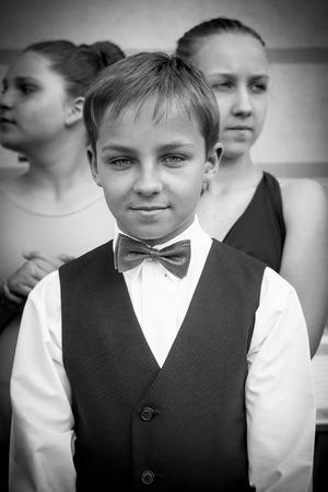 elegantly: Otwock, Poland-May 30, 2015: The elegantly dressed young man looks directly into the camera.