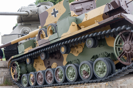 The German Tiger 4 and Soviet T34 tanks