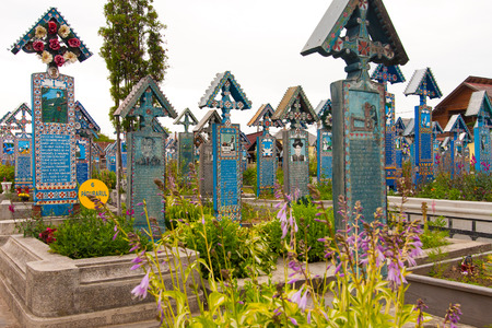 tombstones: Sapanta, Romania-June 29, 2015: Colorful wooden tombstones in the cemetery