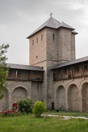 ambulatory: Dragomirna, Romania-June 30 , 2015: .Massive,  brick build monastery in  Drogomirna