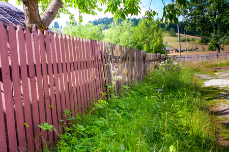 gaff: Wooden fence surrounding the house in the Romanian province