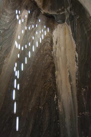 turda: An Interesting, lightning of colorful salt wall in a salt mine Stock Photo