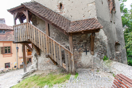 second floor: Sighisoara, Romania-July 03, 2015:   A wooden staircase leading to the second floor of the watchtower