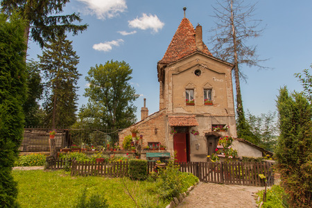 scheduled: Sighisoara, Romania-July 03, 2015: The old historic town house on the edge of the cemetery next to the old town