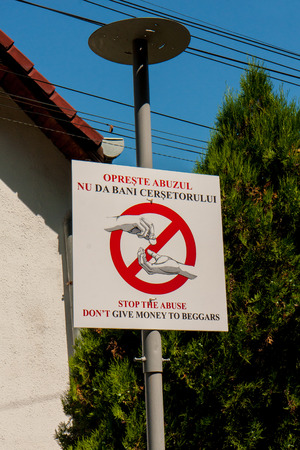 prohibits: The Visitors information board  in front of the old town, which prohibits begging
