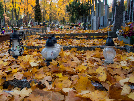 hallowmas: Warsaw, Poland - October 27, 2015: Candles on the graves on the Orthodox cemetery Editorial