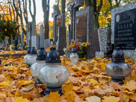 votive candle: Warsaw, Poland - October 27, 2015: Candles on the graves on the Orthodox cemetery Editorial