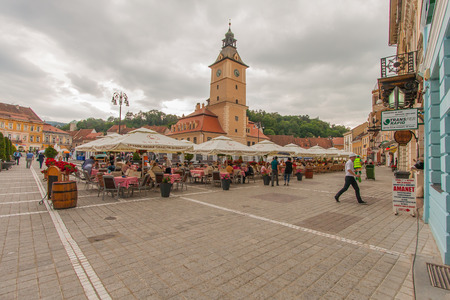 renovated: Brasov, Romania-July 03, 2015:  The renovated market square. Flock of Tourists walking on the main square of the city