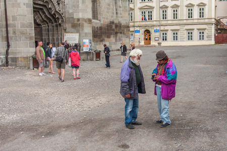 accosting: Brasov, Romania-July 03, 2015:  The homeless and poor people accosting tourists