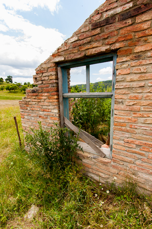 dwelling house: The ruins of the brick dwelling house overgrown with weeds Stock Photo