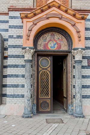 brasov: Brasov, Romania-July 03, 2015: Richly decorated  entrance to the church. Editorial