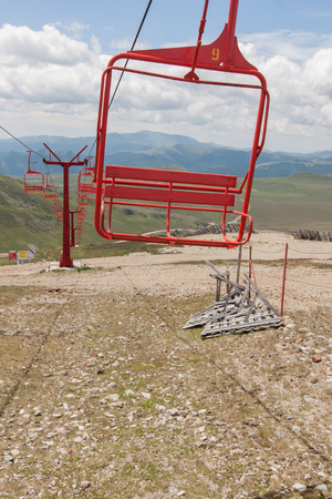 ski lift: Red chairs of unused ski lift.