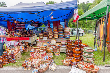 Rasnov, Romania - July 04, 2015: Village fete. Stand with ceramic dishes