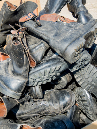 military boots: A heap of old leather worn military boots Stock Photo
