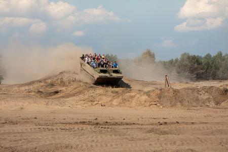 armoured: Borne Sulinowo, Poland - August 23, 2015:  Military armoured vehicle takes tourists around the training ground