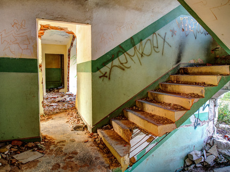 forlorn: Klomino, Poland - August 28, 2015:  Abandoned Soviet city, destroyed staircase.