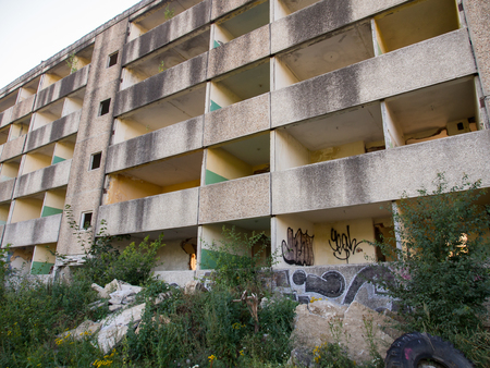 forlorn: Klomino, Poland - August 28, 2015: Abandoned Soviet city, destroyed block of flats where Soviet military used to lived