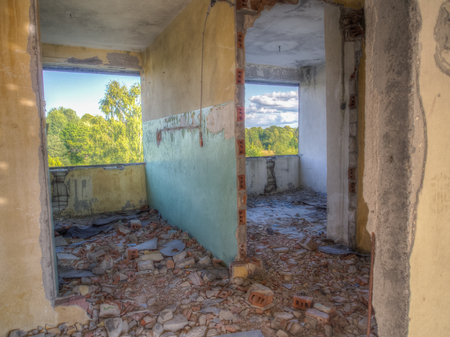 lived: Klomino, Poland - August 28, 2015: Abandoned Soviet city, destroyed block of flats where Soviet military used to lived