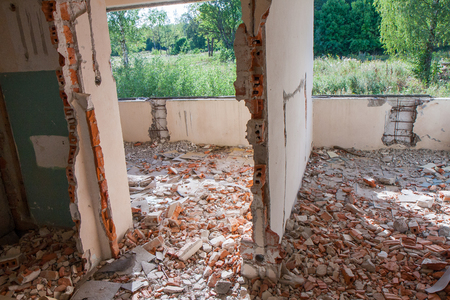 forlorn: Klomino, Poland - August 28, 2015: Abandoned Soviet city, destroyed apartment, with window ripped out
